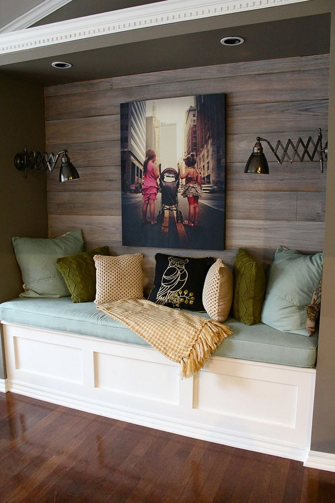 Cozy nook with wood focal wall and industrial sconces