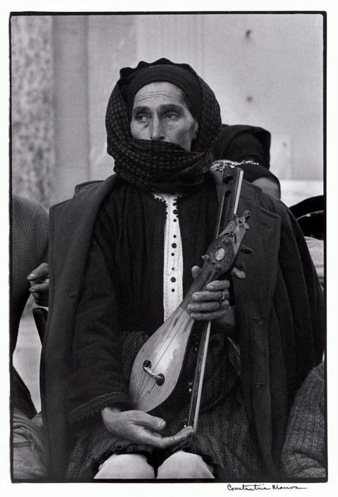 """Greece. Karpathos. Olympos. 1964. Woman and Lyra. """"A Greek Portfolio"""" p.115 © Costa Manos/Magnum Photos"""