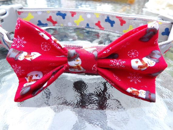 Christmas Snowmen and Snowflakes red dog bow tie. White elastic loop on back for easy on/off! So dapper! Can also be for cats!  --Bow Tie Measurements:  4 inches wide & 2 1/4 inches tall. **We make everything by hand which means that sizes may vary slightly.**  --Machine washable. Tumble dry low or line dry. --So easy to put on! Just slip elastic over collar.  --Has middle layer of interfacing for added support and will keep its  shape.  --You do not have to worry about your dog trying to…