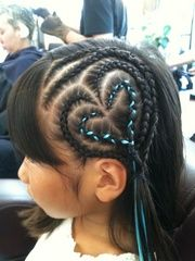 Cornrows heart-shaped with ribbon