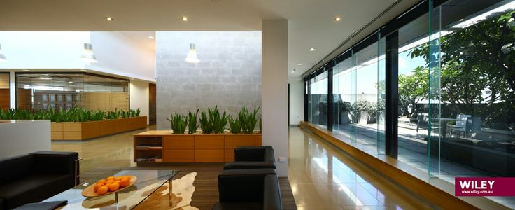 RECEPTION: Welcome   Upon exiting the lift on Level 3, Wiley welcomes you. You will be greeted by our Guest Liasion, and while you wait, why not take a seat on one of our couches and admire our frangipani garden and waterfall. #wiley