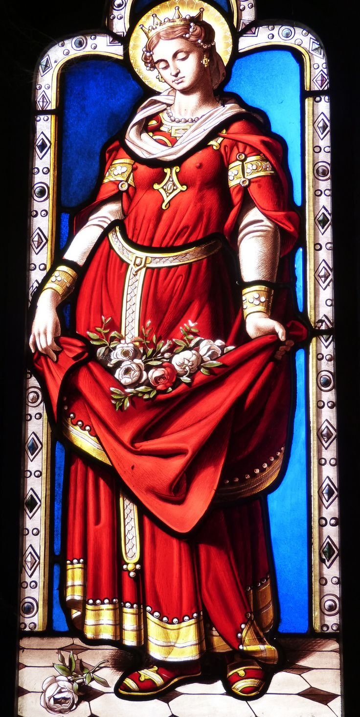 https://flic.kr/p/o611fV | St Elizabeth of Hungary | St Elizabeth of Hungary with her crown and apron full of flowers. Blois château, France.  One of a series of female saints in the Oratory (once the queen's private chapel). Designed by Michel Dumas in 1858, the windows were painted by Claude Lavergne in 1859. Each of the saints depicted has a connection to the Medici or Valois family.