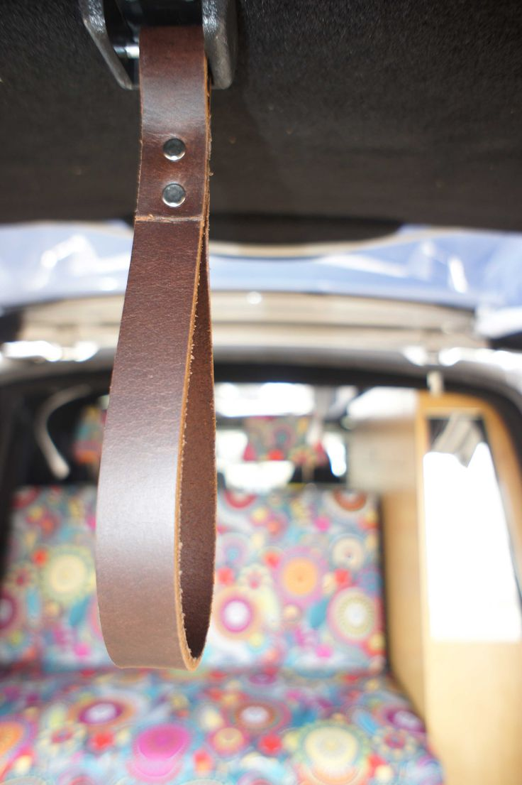 Leather strap to close tailgate in Hippy retro themed campervan by Achtung Camper.