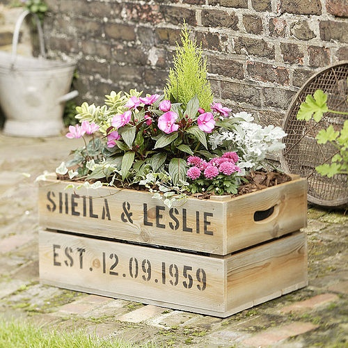 I can't BELIEVE I wasn't the first person on EARTH to think of this! But living proof. Planting your wedding flowers in a fruit crate or wine box.