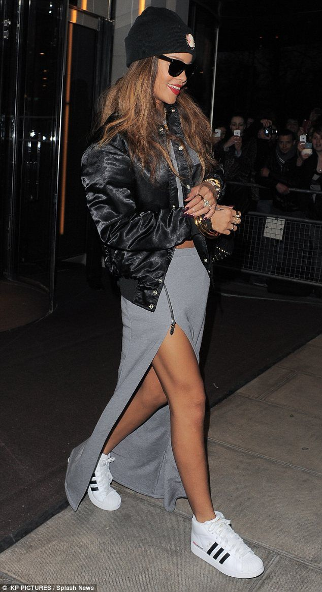 Only emerging after dark! Rihanna leaves her hotel evening after the night before in maxi skirt with thigh high split and crop top