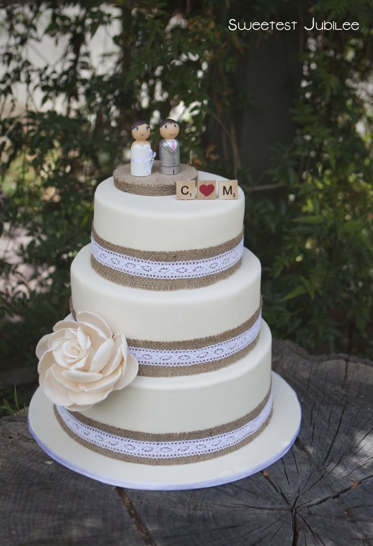 Sweetest Jubilee Three Tiered Wedding Cake With Burlap Ribbon And Large Open Gumpaste Rose