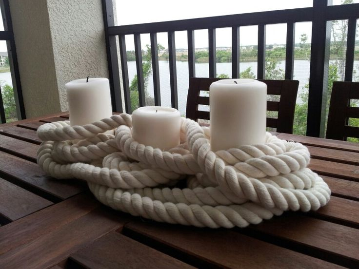 Very cool nautical centerpiece idea with candles and rope. Could definitely see us making this with Candle Impressions Flameless Candles! Wonder where one can find that kind of rope....