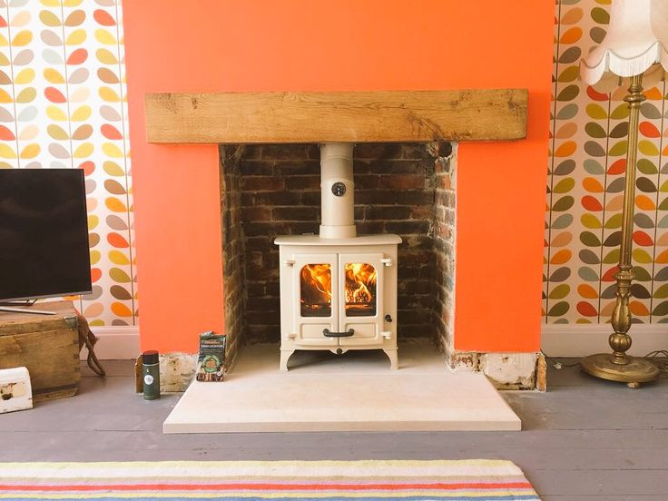 """Corralls Coal on Twitter: """"Another @CharnwoodStoves Island 1 in almond fitted with a Bath stone hearth https://t.co/9Q9WNdYVxn"""""""