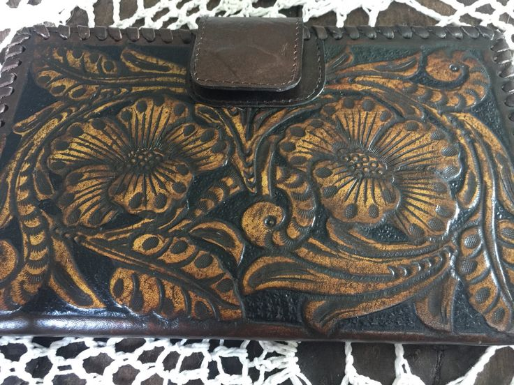 A personal favourite from my Etsy shop https://www.etsy.com/au/listing/506200916/handtooled-genuine-leather-wallet