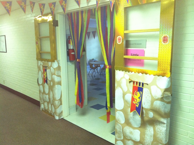 Little People's Kingdom Rock Craft Room  I like the crepe paper tied up in swags.