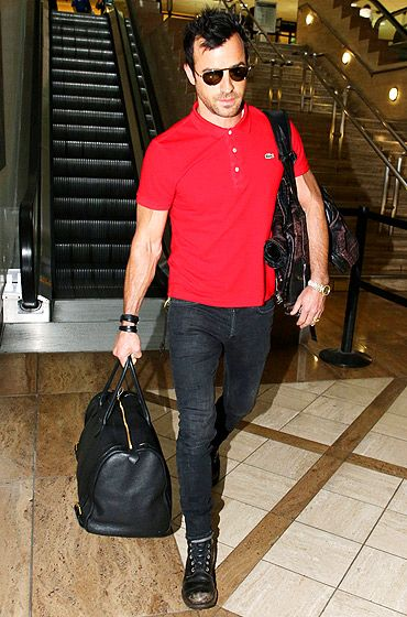 Out of Those Sweats Jennifer Anison's fiance Justin Theroux — whose commando jogging pix titillated Us readers last week — arrived for a flight out of LAX July 2.