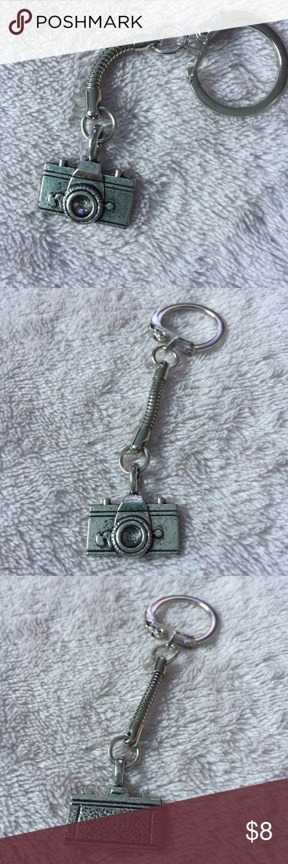 🎁Holiday Sale🎁 Camera Keychain Keychain featuring a little tiny camera. A great gift 🎁 for the holidays.                                              ❌ No trades.                                                                ✅ Discount available when you bundle.              🎁 From now till January 1st when you bundle 3 or more listings you will get 30% off. Jewelry