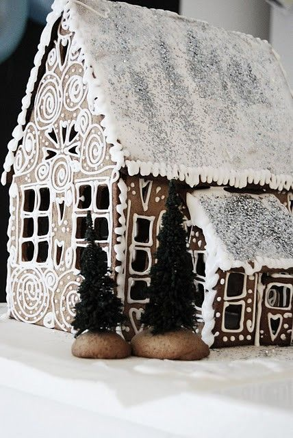 An icing topped gingerbread cottage.