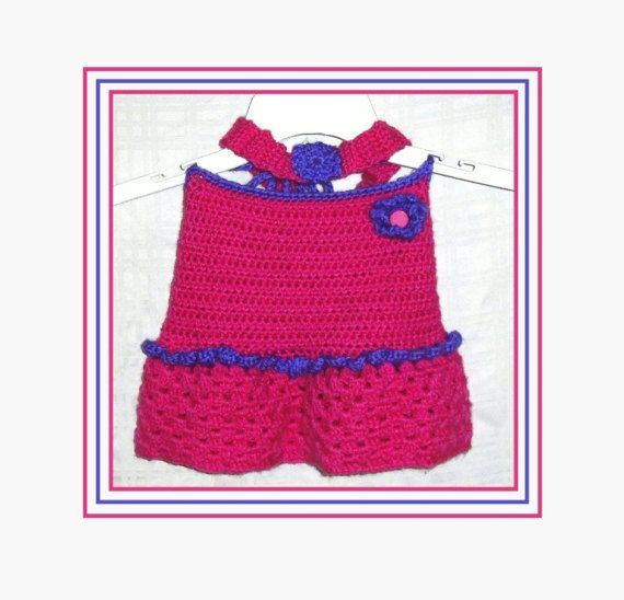 Little Girls Crochet Top, Crochet Headband with Flower, Handmade Girls Summer Top, Pink and Purple Top, Tie Neck and Back, Toddler Size.  Your little girl will be the envy of all her little friends in this adorable halter top and headband set. The handmade crocheted halter top is bright pink with purple trim. It has a ruffle at the waist and a little flower with a button center on the top. The top is a nice tight stitch for good coverage and the peplum flared bottom is done in a pretty open…