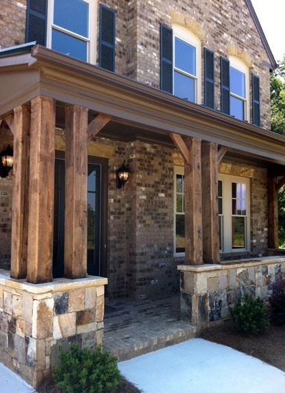 Love the beams on this covered front porch home for Covered front porch