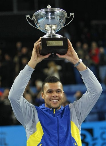 France's Jo-Wilfried Tsonga poses with the trophy after defeating Czech Republic's Tomas Berdych during their final match at the Open 13 tennis tournament in Marseille, southern France, Sunday, Feb. 24, 2013. (AP Photo/Claude Paris)