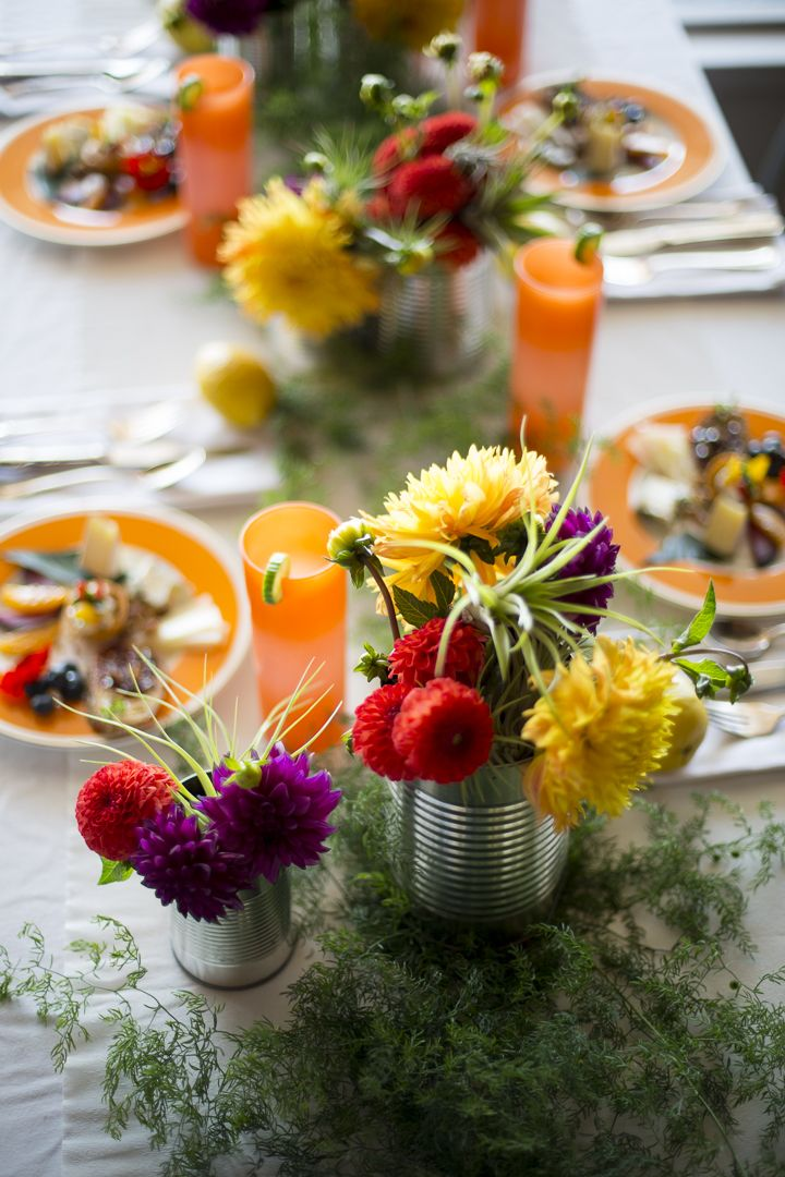Vibrant fall dinner party with tin can centerpieces