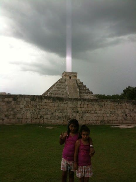 A Los Angeles man named Hector Siliezar snapped a strange photo while on vacation at the site of the ancient Mayan city Chichen Itza in 2009.    Saliezar captured the pyramid El Castillo just as a bolt of lightning struck, and the resulting image appears to show a strong beam of light emanating directly from the top of the pyramid.