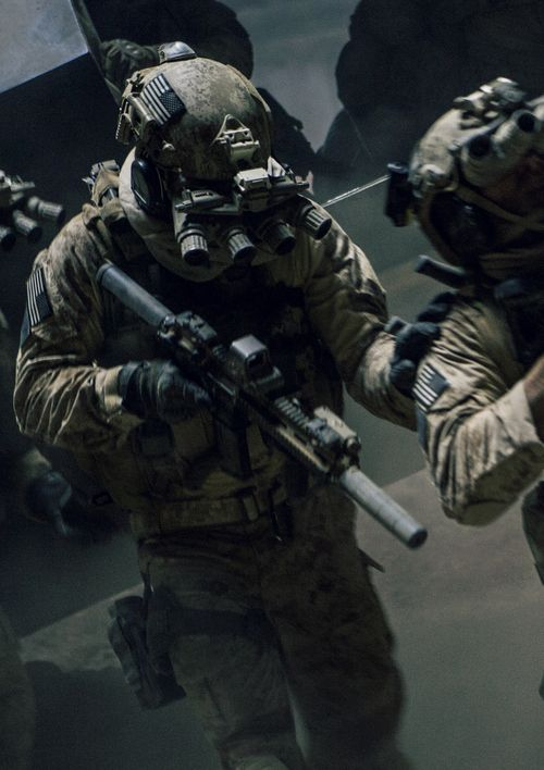 Special Operations Service Members with panoramic night vision goggles