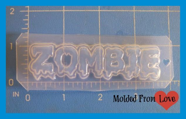This is a handmade Thick but flexible Poly-Plastic mold that is made to use with resin, but, can also be used with Clay, soap, Chocolates ect... This mold features a 3' wide Layered drippy Zombie word Perfect size for a pendant, bow center, decoden ect.. If pieces come out not shiny, simply coat with resin or resin spray. That is what I do with all of my pieces anyway.