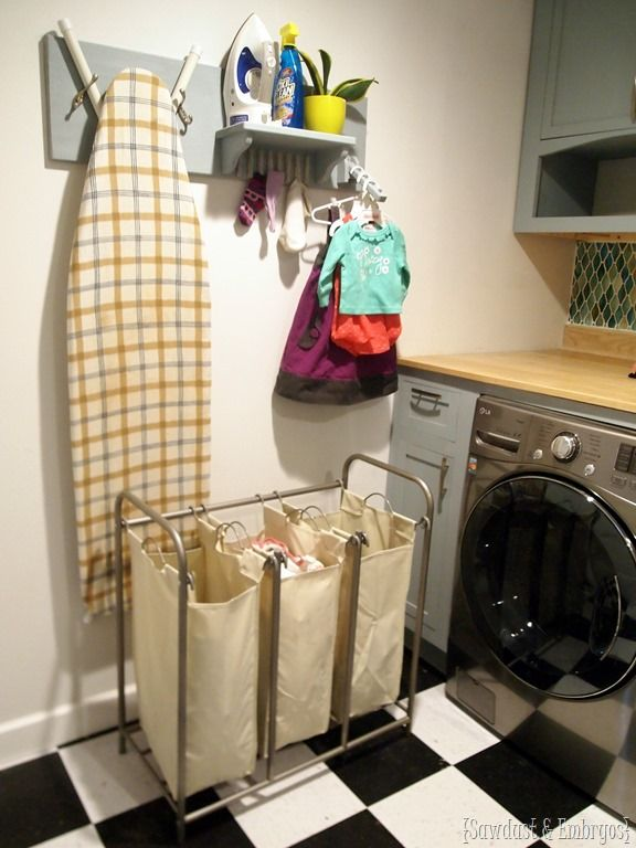 DIY Organization for the Laundry Room... holds iron, ironing board, unmatched socks, and hangers! {Sawdust and Embryos}