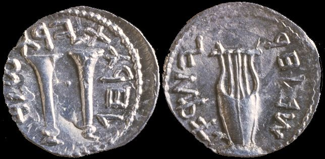 """Coins from period of Bar Kokhba revolt, (Roman period) Coin from Jewish Bar Kokhba revolution. Written in Paleo-Hebrew alphabet also known as Ktav Ivri. Obverse: trumpets surrounded by """"To the freedom of Jerusalem"""". Reverse: A lyre surrounded by """"Year two to the freedom of Israel"""""""