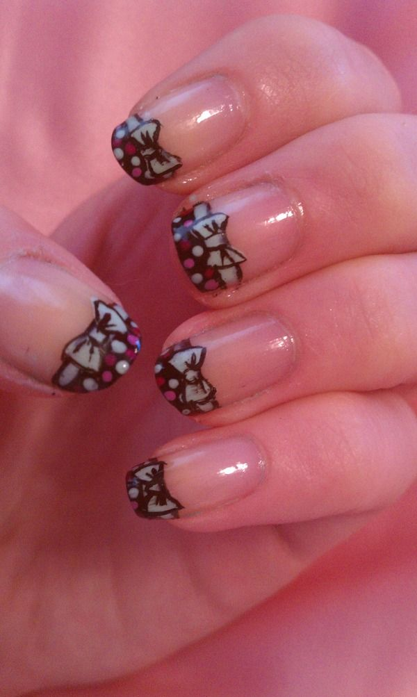 Bow Nails  Not sure I'd do it on all nails but like :)