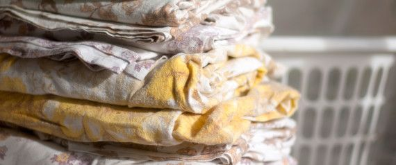 How To Fold Fitted Sheets Without Losing Your Mind