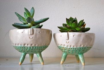 Handmade plant pots with happy faces by London-based ceramicist Stella Baggott.