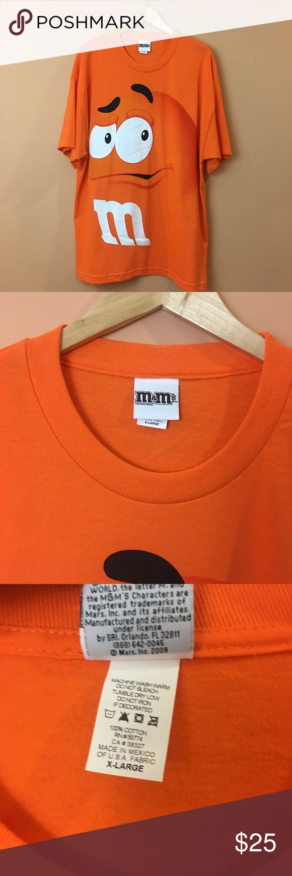NWOT Unisex M&M's Official Orange Tee Unisex M&M's Official Orange Tee. 100% cotton. Pit to pit 24 inches length 32 ‏inches M&M's Tops Tees - Short Sleeve