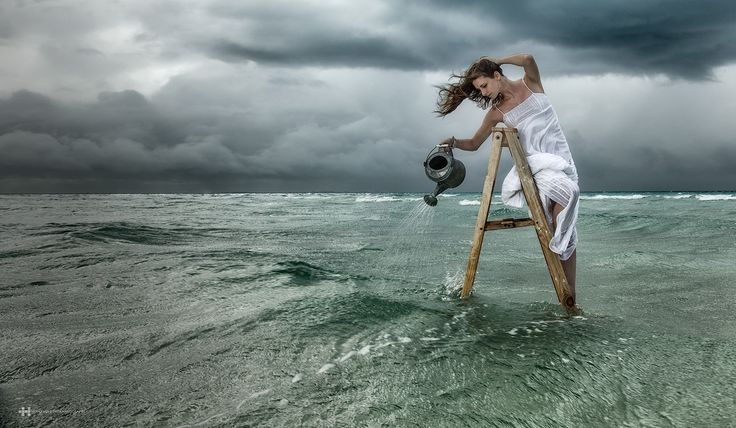 "Hurricane Sower - Hurricane Sower was taken on location at Isla Mujeres, Mexico during the incoming hurricane ""Irene"". Curiously the name of the woman in the portrait was Irene too. The idea of making this images was planed years before the photo was taken; Looking for the best location, building the the ladder, finding the model and of course waiting for the perfect hurricane. Finally in August 21th of 2011 all was set to do the shot.  We traveled to the location one day before navigation…"