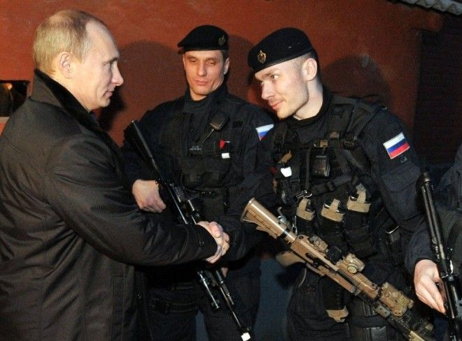 Putin with FSB Alpha Group officers in Chechnya.Putin with FSB Alpha Group officers in Chechnya. Note the customized AK.