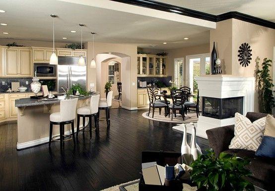 Dark hardwood floors & molding and open floor plan