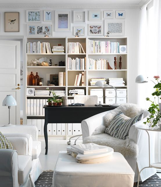 float the desk in front of book shelves. I love the way they've filled up the wall space between top of the shelves & the ceiling. Very ingenious!