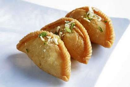Gujiya is the famous Indian Sweet Dish, made with all-purpose flour, ghee, khoya and cardamoms. Holi is the main festival in India and Gujiya is highly mad