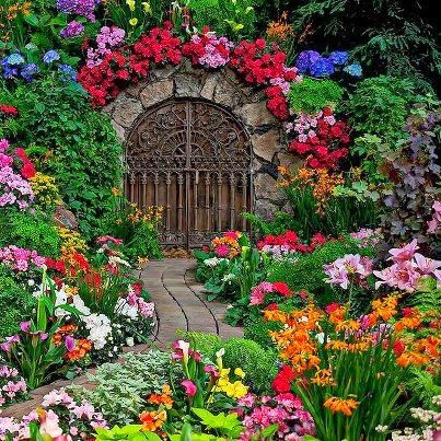 Beautiful gate in garden and oh my what a garden for Beautiful garden pictures