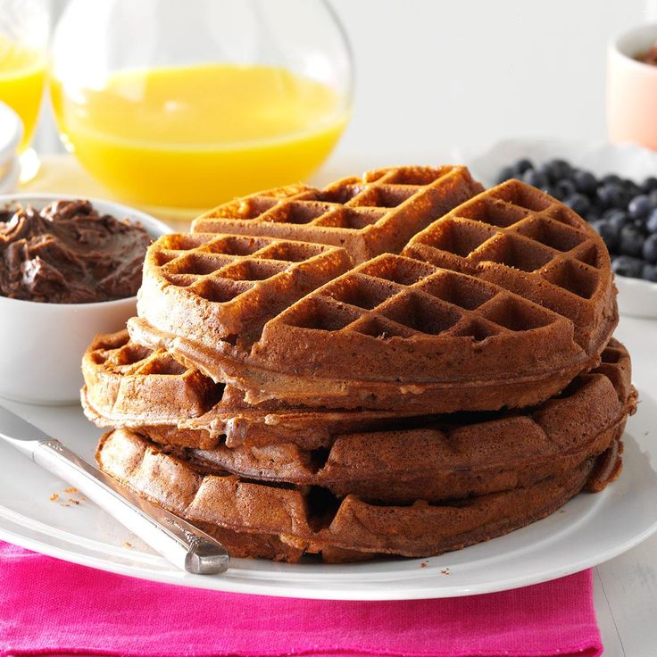 Pecan Chocolate Waffles Recipe -If you like waffles and chocolate, this recipe is for you. These tender but crunchy waffles are great for breakfast, brunch or an after-dinner dessert. Instead of chocolate topping, top with berries and whipped cream or simply sprinkle with powdered sugar. —Agnes Golian, Garfield Heights, Ohio