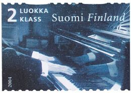 Postage stamp issued by Finland depicting Jean Sibelius' hands playing piano.