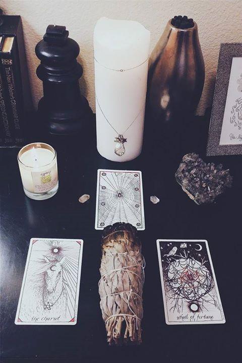 altar: white pillar candle + talisman + sage + Tarot candles