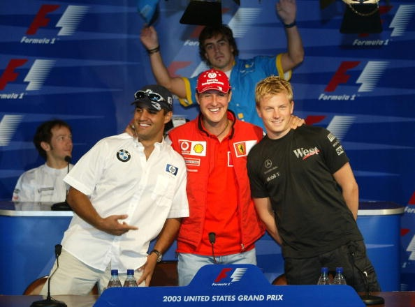 Perfect photobomb by Fernando Alonso (with Juan Pablo Montoya, Michael Schumacher and Kimi Räikkönen)