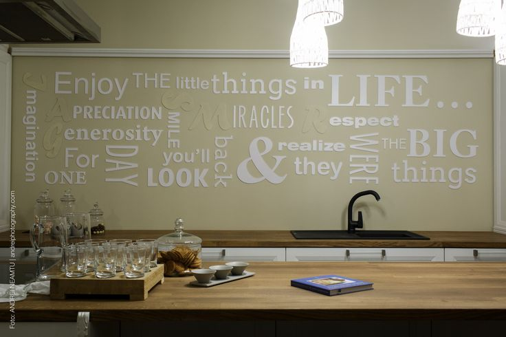 In the kitchen: the written wall represents  the mother's messages to the fanily members, the different letters representing the name of each member of the family.