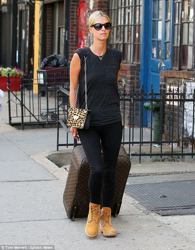 Baggage: The little sister of Paris Hilton arrived at her apartment in New York City rolli...