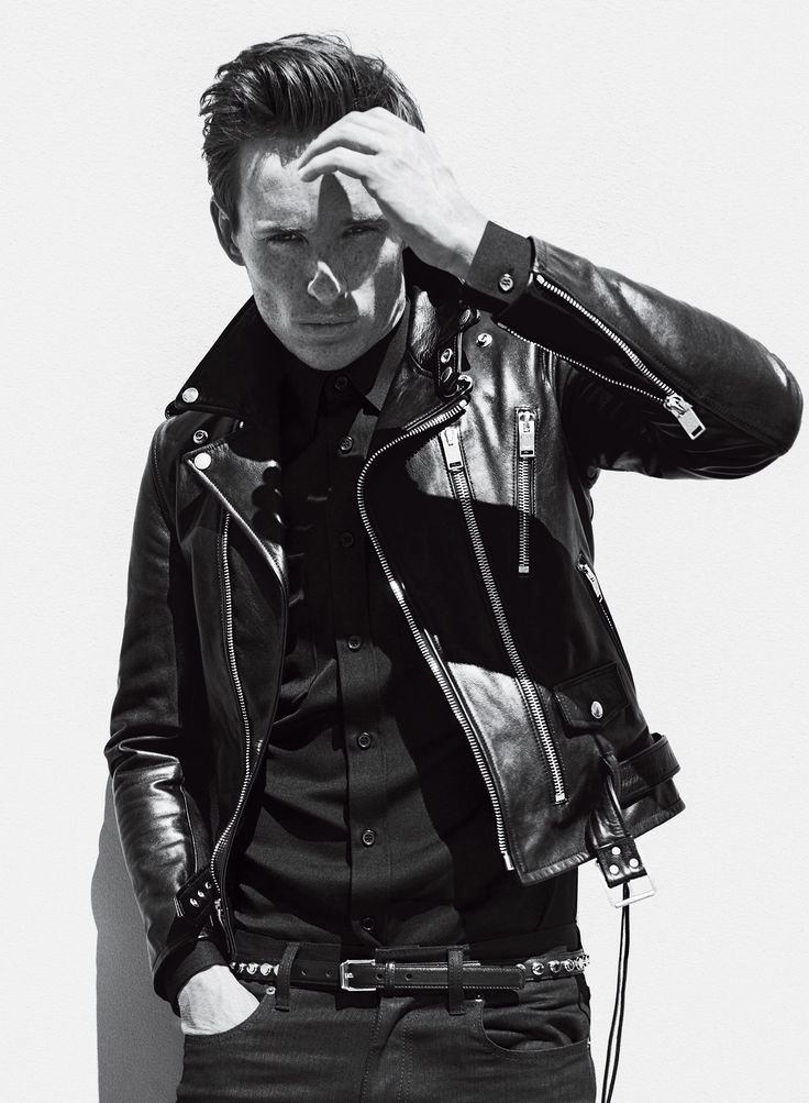 Updated '50s greaser style: a motorcycle jacket and slicked back hair.