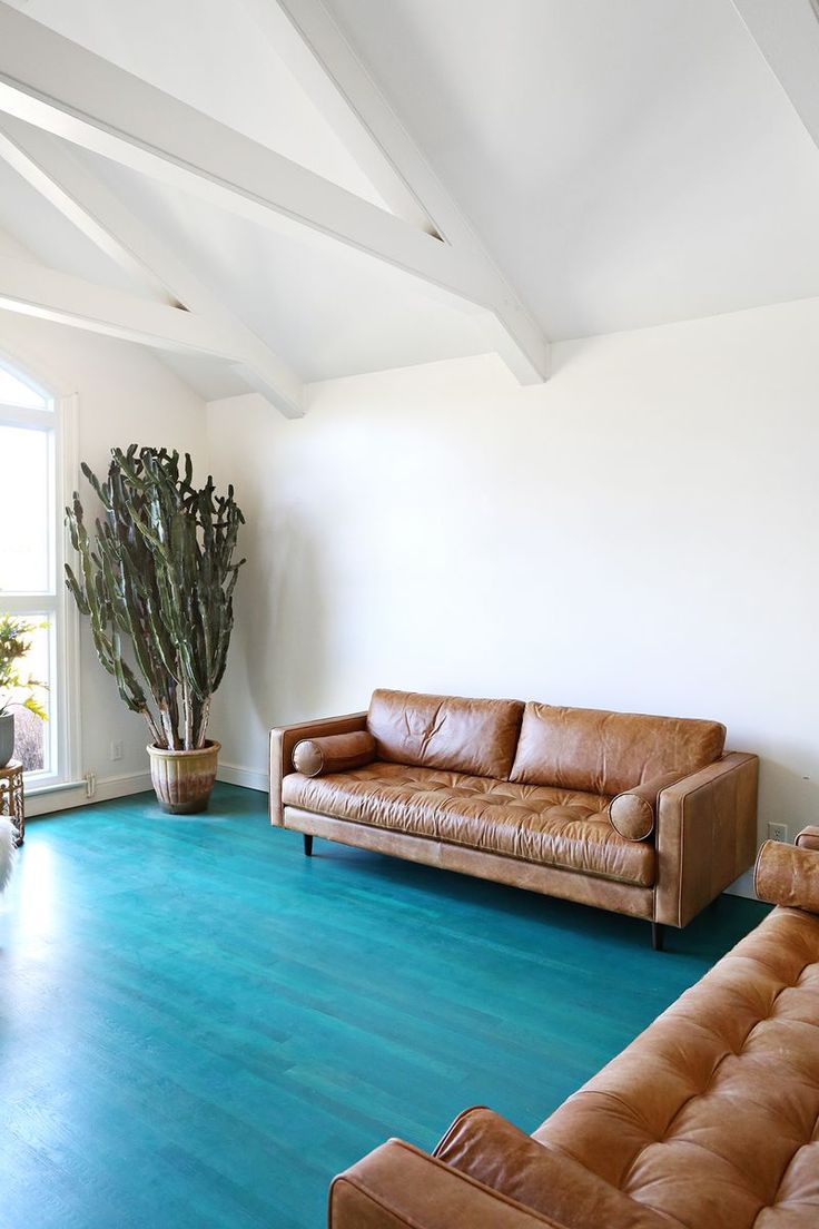 Progress Report: Living Room – A Beautiful Mess Turquoise floors and worn in leather sofas Decor, Wood Floor Stain Colors, Painted Wood Floors, Flooring, Color Washed Wood, House Flooring, Log Home Interior, Living Room Decor, Room Decor