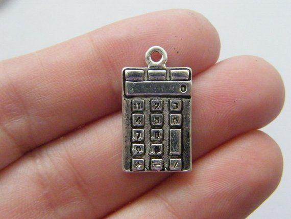 4 Calculator charms antique silver tone PT4
