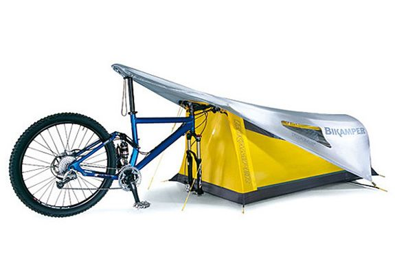 The Bikecamper is a personal shelter that utilizes a bicycle and its front wheel in place of conventional tent poles. The canopy of the Bikamper is constructed of durable, waterproof coated 45D ripstop nylon and features three mesh windows for ventilation and stargazing on pleasant nights. Both tent and fly pack down to a small, space saving size