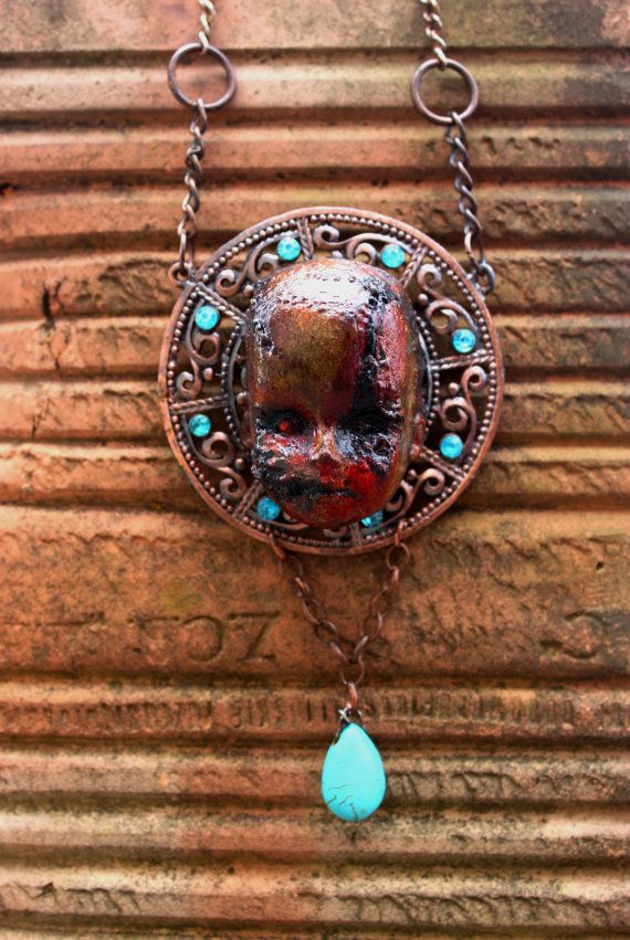 This doll head is authentic and has been repurposed (its eco friendly) which I think adds to the post apocalyptic beauty.  Following necklace will