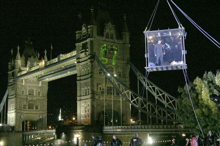 September 5,2003: MAGICIAN DAVID BLAINE LEAVES BOX SUSPENDED OVER LONDON  -   Blaine begins an endurance stunt in which he was sealed inside a transparent Plexiglas case. The case was suspended 30 feet (9.1 metres) in the air next to Potters Fields Park on the south bank of the River Thames in London, and measured 3 feet (0.9 metres) by 7 feet (2.1 metres). A webcam was installed inside the case so that viewers could observe his progress. The stunt lasted 44 days, during which Blaine…