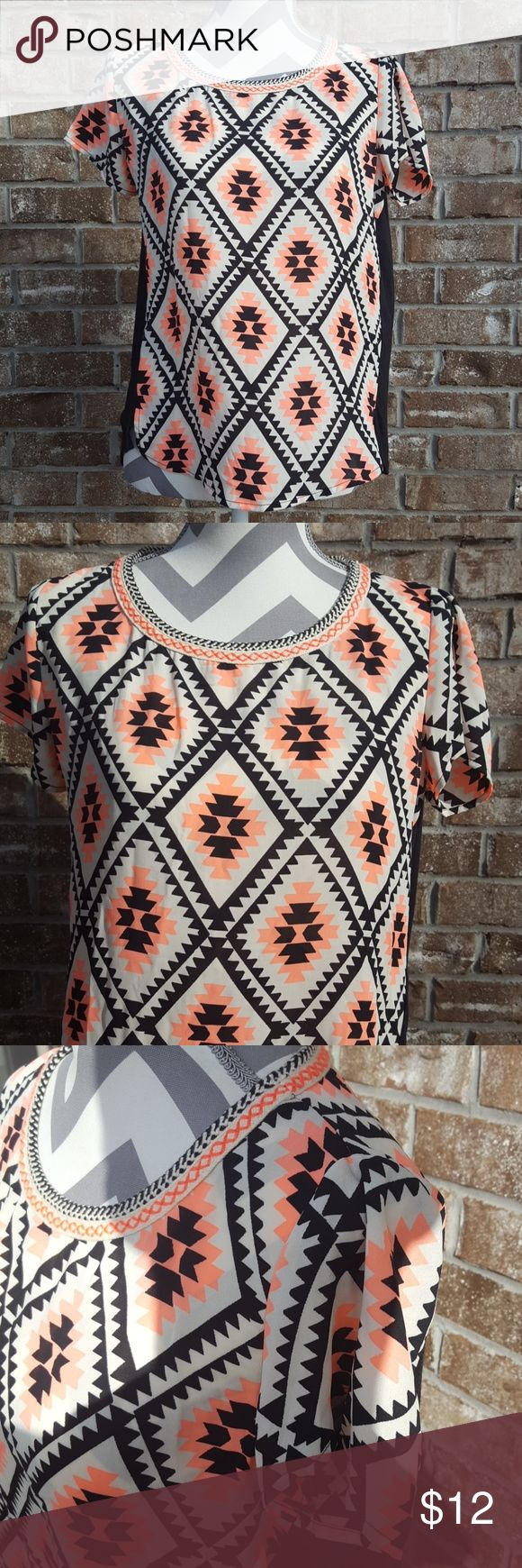 Xhilaration Medium Aztec Blouse This beautiful top incorporates bright coral and black into an Aztec design. The neckline has a very unique detail. The front is completely print and the back is partially the print as well as black. Please see my closet for bundle ideas including Brands like Kate Spade, Michael Kors & More!!! Xhilaration Tops Blouses