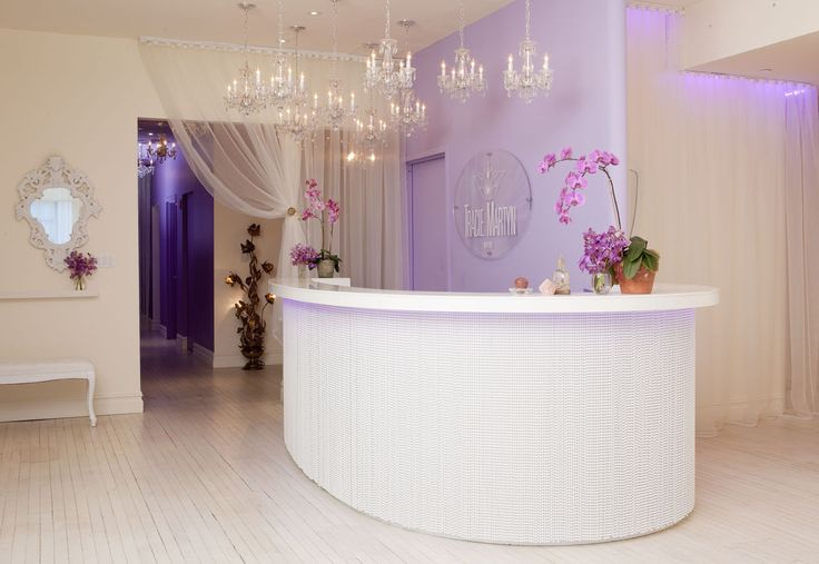 Tracie Martyn Salon Interior Reception Area. Not sure about the desk, but I love the Lavendar wall and Chandeliers.